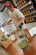 Brian Owens, brewer at O'Fallon Brewery, measures out the hops for a batch of O'Fallon Unfiltered wheat.