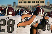 Greece Arcadia players huddle before a game at Eastridge High School on Friday, September 2, 2016.