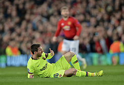 MANCHESTER, ENGLAND - Thursday, April 11, 2019: Barcelona's captain Lionel Messi lies injured after being hit in the face during the UEFA Champions League Quarter-Final 1st Leg match between Manchester United FC and FC Barcelona at Old Trafford. Barcelona won 1-0. (Pic by David Rawcliffe/Propaganda)