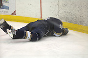 Notre Dame's Ian Cole lays on the ice after a hard check during the Irish's Friday night game against Lake Superior State in Sault Ste. Marie.