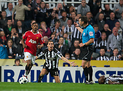 NEWCASTLE, ENGLAND - Tuesday, April 19, 2011: Newcastle United's Peter Lovenkrands cannot believe a penalty wasnt awarded during the Premiership match against Manchester United at St James' Park. (Photo by David Rawcliffe/Propaganda)