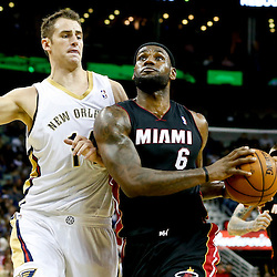 Oct 23, 2013; New Orleans, LA, USA; Miami Heat small forward LeBron James (6) drives past New Orleans Pelicans power forward Jason Smith (14) during the second half of a preseason game at New Orleans Arena. The Heat defeated the Pelicans 108-95. Mandatory Credit: Derick E. Hingle-USA TODAY Sports