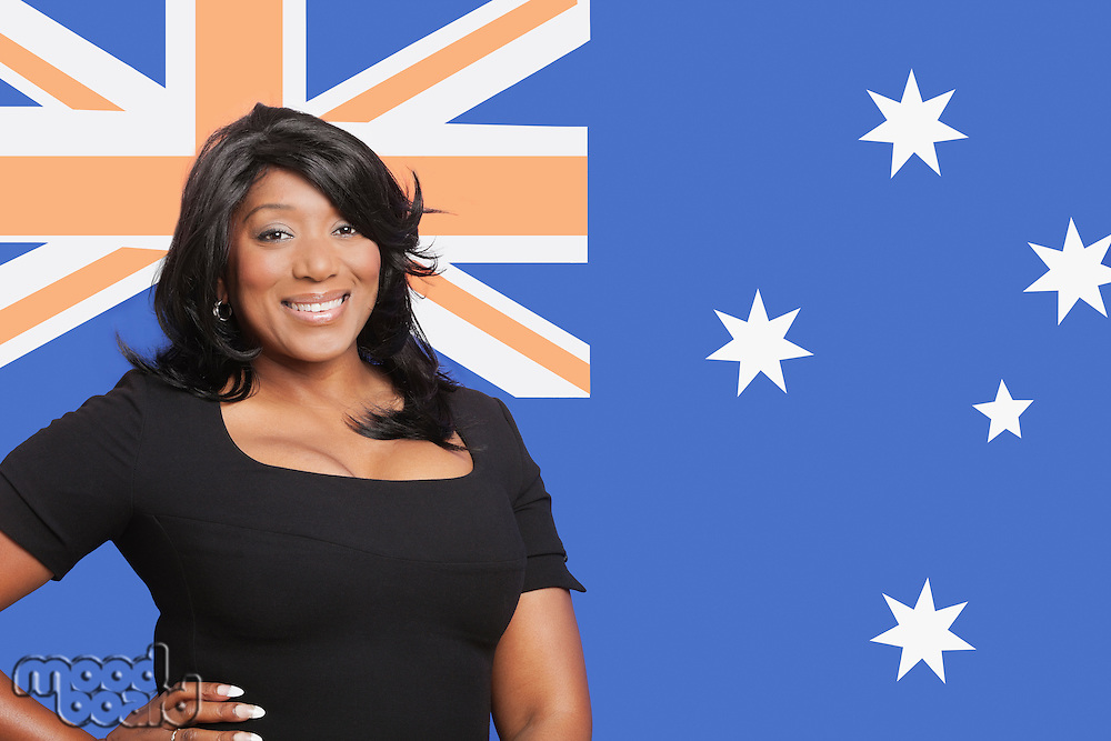 Portrait of casual mixed race woman against Australian flag