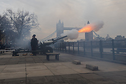 © Licensed to London News Pictures. 06/02/2017. LONDON, UK.  Member of the Honorary Artillery Company fire a 62 round gun salute at the Tower of London, in front of Tower Bridge to mark the Sapphire Jubilee of HM Queen Elizabeth II. Queen Elizabeth II is the first British monarch ever to celebrate a Sapphire Jubilee and today marks 65 years since Her Majesty The Queen's accession to the throne. Photo credit: Vickie Flores/LNP