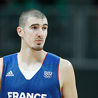 29 July 2012: Nando De Colo looks dejected during the 98-71 Team USA victory over Team France, during the men's basketball preliminary, at the Basketball Arena, in London, Great Britain.