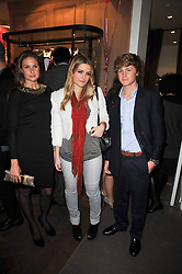 Left to right, MARINA VAUGHAN, the HON.PHILIPPA CADOGAN and ALEXANDER VAUGHAN at the launch party of 'Songs For Sorrow' hosted by Alber Elbaz and Mika held at Lanvin, 32 Savile Row, London on 11th November 2009.