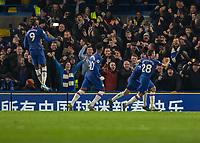 Football - 2019 / 2020 Premier League - Chelsea vs. Arsenal<br /> <br /> Chelsea players celebrate with goalscorer Jorginho(Chelsea FC) as he scores from the penalty spot at Stamford Bridge <br /> <br /> COLORSPORT/DANIEL BEARHAM