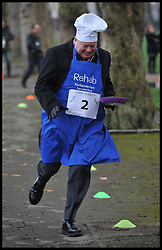 Lord Kennedy of Southwark  MP's and Lords race against political Journalist in the Rehab Parliamentary Pancake Shrove Tuesday race a charity event which sees MPs and Lords joined by media types in a race to the finish. Victoria Tower Gardens, Westminster, Tuesday February 12, 2013. Photo By Andrew Parsons / i-Images