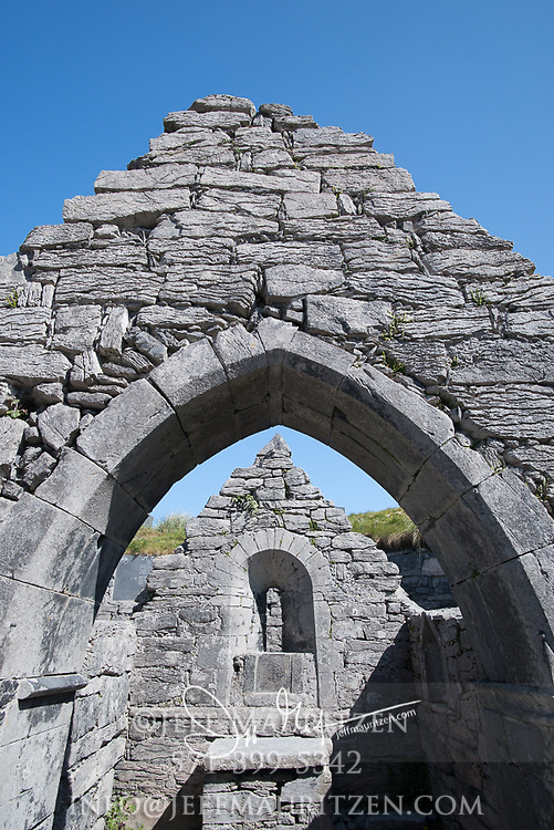 """Saint Caomhan's church or the """"sunken church"""" at Inisheer, (Inis Oirr), County Galway, Ireland."""