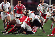 Rugby World Cup. England v Tonga. Paul Sackey gets caught in a crunch tackle at the Parc des Princes, Paris, France. Friday 28 September 2007. Photo: Ron Gaunt/Sportzpics