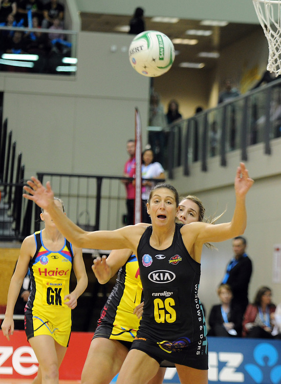 Magics' Irene van Dyk cahses the ball against the Pulse in the ANZ Netball Champions at TSB Stadium, Wellington, New Zealand, Sunday, April 28, 2013. Credit:SNPA / Ross Setford