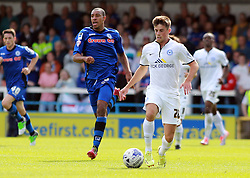 Peterborough United's Kenneth McEvoy in action with Rochdale's Rhys Bennett - Photo mandatory by-line: Joe Dent/JMP - Mobile: 07966 386802 09/08/2014 - SPORT - FOOTBALL - Rochdale - Spotland Stadium - Rochdale AFC v Peterborough United - Sky Bet League One - First game of the season