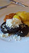 Neusiedlersee (Lake Neusiedl), Podersdorf am See. Burgenland, Austria.<br /> Zur Dankbarkeit.<br /> Blunzn (crispy fried blood pudding).