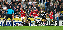 NEWCASTLE, ENGLAND - Tuesday, April 19, 2011: Manchester United's Anderson brings down Newcastle United's Peter Lovenkrands but no penalty is given during the Premiership match at St James' Park. (Photo by David Rawcliffe/Propaganda)