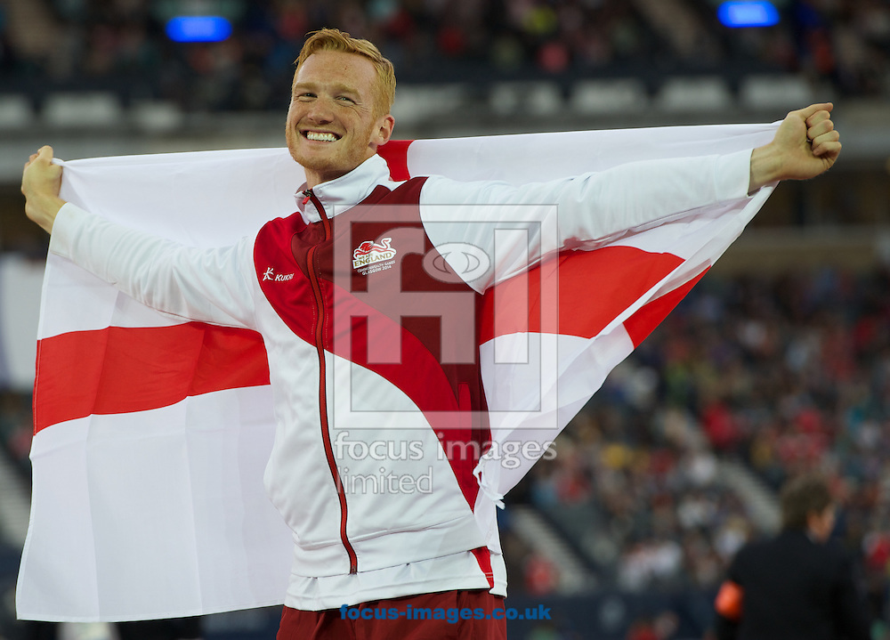 Greg Rutherford England celebrates winning the mens long jump competition on day four of the athletics  at Hampden Park, Glasgow<br /> Picture by Alan Stanford/Focus Images Ltd +44 7915 056117<br /> 29/07/2014