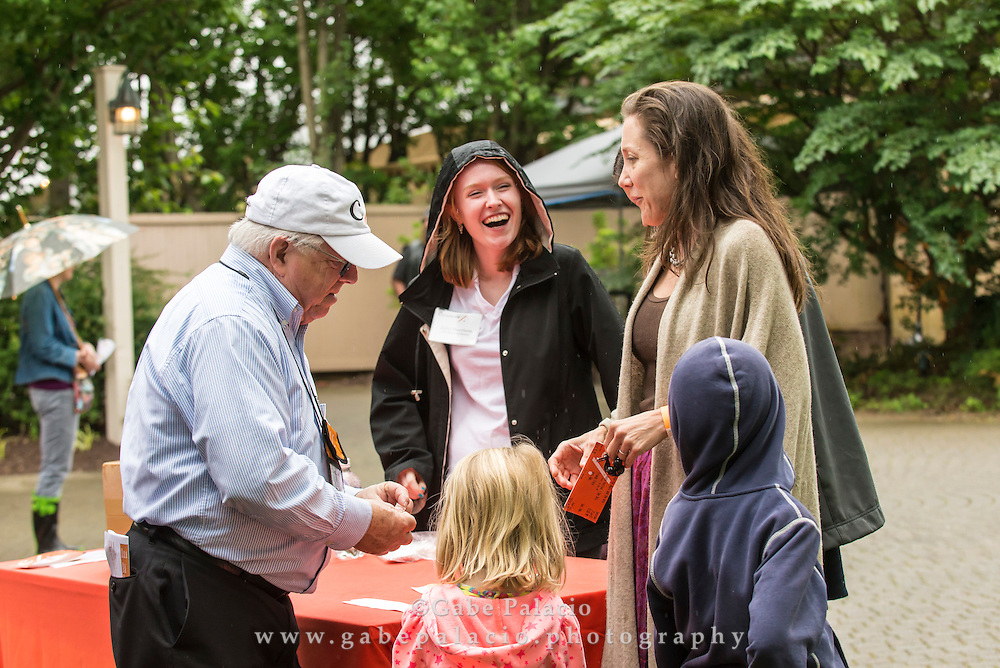 Families enjoy the American Roots Music Festival at Caramoor in Katonah New York on June 27, 2015. <br /> (photo by Gabe Palacio).