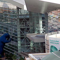 USA, Colorado, Denver. Blue Bear looks in on the Colorado Convention Center, downtown Denver (view from Four Seasons Hotel).
