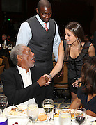 ATLANTA, GA - MAY 14:  Ryan Howard (center) and Howard's fiancee Krystal Campbell talk with Beacon Award recipient Morgan Freeman at the MLB Beacon Awards Banquet at the Omni Hotel on May 14, 2011 in Atlanta, Georgia.  (Photo by Mike Zarrilli/Getty Images)