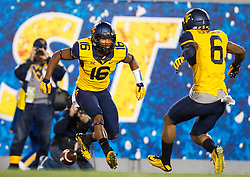 Oct 10, 2015; Morgantown, WV, USA; West Virginia Mountaineers cornerback Terrell Chestnut (16) celebrates with safety Dravon Askew-Henry (6) after an interception during the first quarter against the Oklahoma State Cowboys at Milan Puskar Stadium. Mandatory Credit: Ben Queen-USA TODAY Sports