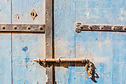 dead bolt and Blue Weathered wooden background and