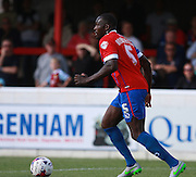 Dagenham central defender Nyron Nosworthy brings the ball out from defence during the Sky Bet League 2 match between Dagenham and Redbridge and Newport County at the London Borough of Barking and Dagenham Stadium, London, England on 19 September 2015. Photo by Bennett Dean.