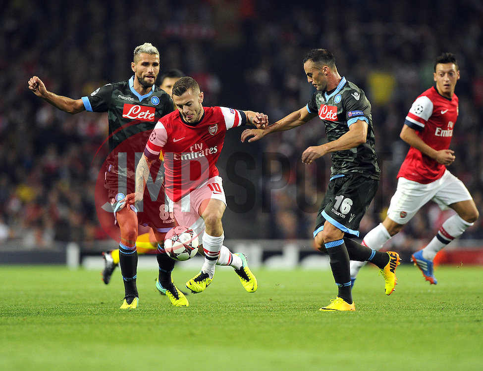 Arsenal's Jack Wilshere battles for the ball with Napoli's Giandomenico Mesto and Napoli's Valon Behrami - Photo mandatory by-line: Joe Meredith/JMP - Tel: Mobile: 07966 386802 01/10/2013 - SPORT - FOOTBALL - Emirates Stadium - London - Arsenal V Napoli - Champions League - Group F