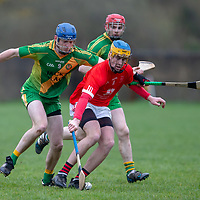 Eire Og's Dara Walsh is tackled by O'Callaghan's Mills's Michael McGrath and Sean O'Gorman