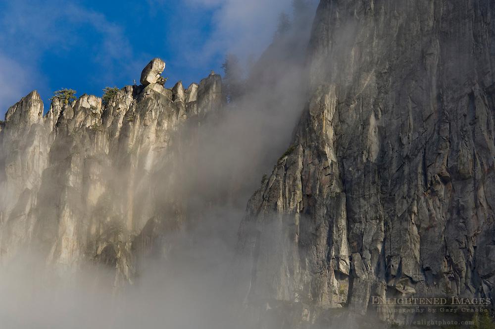 Clouds and sheer granite clif walls above Yosemite Valley, Yosemite National Park, California