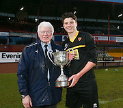 Dave Forbes presents the trophy to Grove Academy captain Mark Smith after his side had beaten St Johns RC High School in the Under 15s senior cup final at Dens Park - Under 15s senior cup final sponsored by Dundee FC Supporters Society<br /> <br />  - &copy; David Young - www.davidyoungphoto.co.uk - email: davidyoungphoto@gmail.com