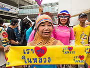 "14 JULY 2013 - BANGKOK, THAILAND:  About 150 members of the so called ""White Mask"" movement marched through the central shopping district of Bangkok Sunday to call for the resignation of Yingluck Shinawatra, the Prime Minister of Thailand. The White Mask protesters are strong supporters of the Thai monarchy. They claim that Yingluck is acting as a puppet for her brother, former Prime Minister Thaksin Shinawatra, who was deposed by a military coup in 2006 and now lives in exile in Dubai.       PHOTO BY JACK KURTZ"