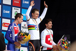 Silver medalist Bradley Wiggins of Great Britain (l), gold medalist Tony Martin of Germany(c) and bronze medalist Fabian Cancellara of Switzerland (r) stand on the podium after the Elite Men's Time Trial on day three of the UCI Road World Championships on September 21, 2011 in Copenhagen, Denmark. (Photo by Marjan Kelner / Sportida Photo Agency)