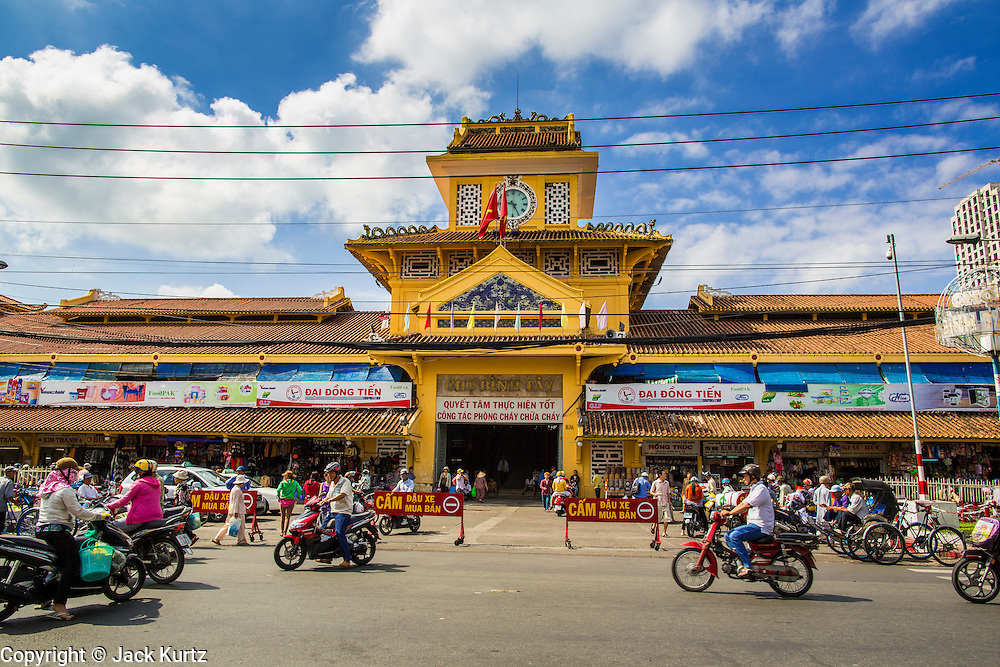 "12 APRIL 2012 - HO CHI MINH CITY, VIETNAM:  The main entrance to Binh Tay Market. Binh Tay market is the largest market in Ho Chi Minh City and is the central market of Cholon. Cholon is the Chinese-influenced section of Ho Chi Minh City (former Saigon). It is the largest ""Chinatown"" in Vietnam. Cholon consists of the western half of District 5 as well as several adjoining neighborhoods in District 6. The Vietnamese name Cholon literally means ""big"" (lon) ""market"" (cho). Incorporated in 1879 as a city 11 km from central Saigon. By the 1930s, it had expanded to the city limit of Saigon. On April 27, 1931, French colonial authorities merged the two cities to form Saigon-Cholon. In 1956, ""Cholon"" was dropped from the name and the city became known as Saigon. During the Vietnam War (called the American War by the Vietnamese), soldiers and deserters from the United States Army maintained a thriving black market in Cholon, trading in various American and especially U.S Army-issue items.         PHOTO BY JACK KURTZ"