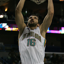 Peja Stojakovic #16 of the New Orleans Hornets dunks against the Houston Rockets  in the third quarter of their NBA game on March 19, 2008 at the New Orleans Arena in New Orleans, Louisiana. The New Orleans Hornets defeated  the Houston Rockets 90-69.