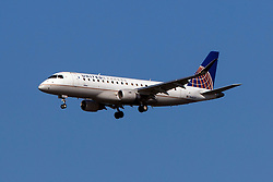 Embraer ERJ 170-200 LR (N145SY) operated by SkyWest Airlines for United Express on approach to San Francisco International Airport (KSFO), San Francisco, California, United States of America
