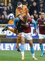 Photo: Steve Bond/Richard Lane Photography. Wolverhampton Wanderers v Aston Villa. Barclays Premiership 2009/10. 24/10/2009. John Carew is beaten in the air by Jody Craddock