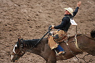 Saddle Bronc Rider Anthony Bello gets a no score after a short ride on Bad Eye, 27 July 2007, Cheyenne Frontier Days
