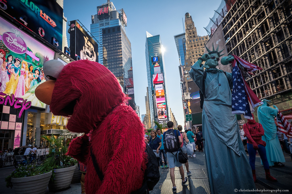 Some costumed characters get ready for their performances at Times Square, New York City.