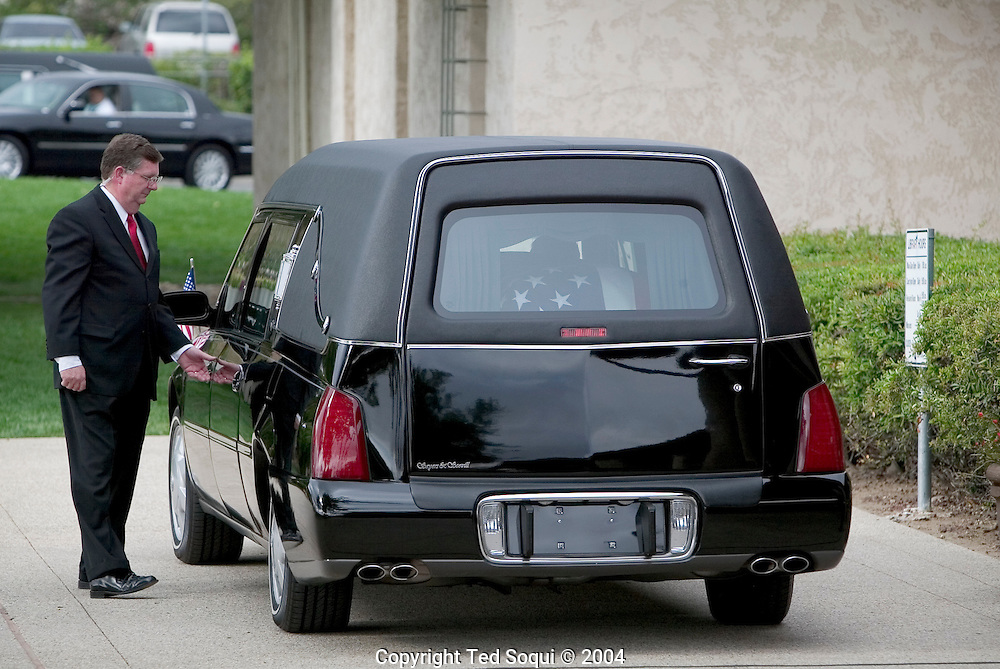 A driver getting in the hearse that will transport Ronald Reagan's remains to Pt. Magu for a flight to Wash. DC...Ronald Reagan Library, Simi Valley, CA USA 6/9/04.