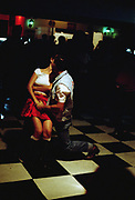Couple finishing up their dancing with a kiss, Brazil, 2000's