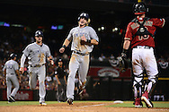 PHOENIX, AZ - JULY 06:  Travis Jankowski #16 and Wil Myers #4 of the San Diego Padres round third base to score during the seventh inning against the Arizona Diamondbacks at Chase Field on July 6, 2016 in Phoenix, Arizona.  (Photo by Jennifer Stewart/Getty Images)