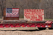 Accord, New York  - Signs along Route 209, where the public lined up to honor U.S. Army Sgt. Shawn M. Farrell II on May 7, 2014. Farrell died April 28 when forces attacked his unit with small arms fire in Afghanistan.