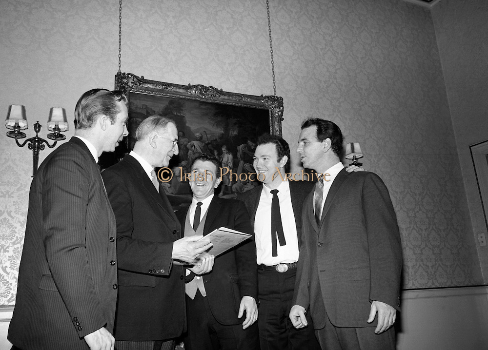 The Clancy Brothers and Tommy Makem, (on right), discard their trademark Aran jumpers and caps for a visit to Aras an Uachtarain. .15.01.1964