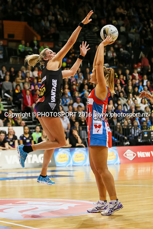 Waikato BOP's Leana De Bruin jumps to block a shot from NSW Swift's Stephanie Wood during the ANZ Netball Championship semi final between the Waikato BOP Magic and the NSW Swifts, played at Claudelands Arena, Hamilton, New Zealand on Monday 25 July 2016.  Copyright Photo: Bruce Lim / www.photosport.nz
