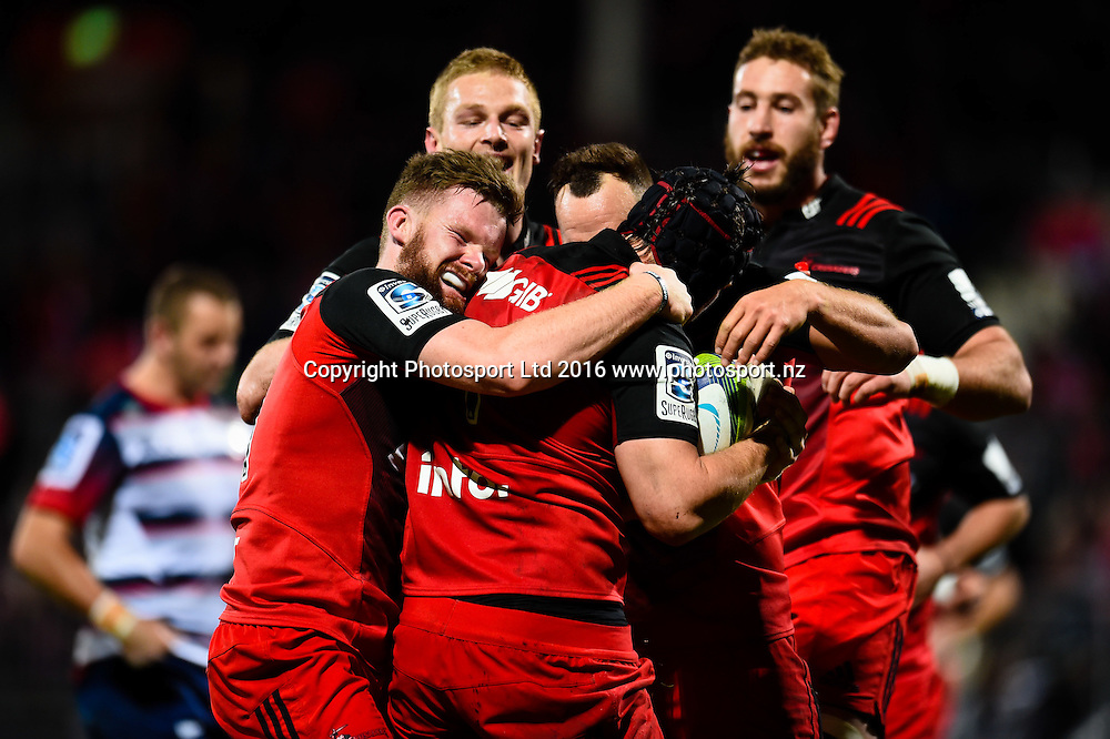 The Crusaders celebrates Matt Todd of the Crusaders try during the Super Rugby Match, Crusaders V Rebels, AMI Stadium, Christchurch, New Zealand. 9th July 2016. Copyright Photo: John Davidson / www.photosport.nz