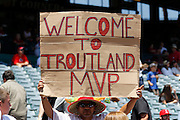 ANAHEIM, CA - JULY 21:  A fan holds up a sign for Mike Trout #27 of the Los Angeles Angels during the game against the Texas Rangers on Saturday, July 21, 2012 at Angel Stadium in Anaheim, California. The Rangers won the game 9-2. (Photo by Paul Spinelli/MLB Photos via Getty Images)