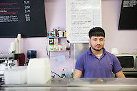 Portrait of a young man working in cafe