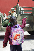 A young girl wearing a princess backpack waves to Mexican Soldiers during a parade to celebrate the 251st birthday of the Mexican Independence hero Ignacio Allende January 21, 2020 in San Miguel de Allende, Guanajuato, Mexico. Allende, from a wealthy family in San Miguel played a major role in the independency war against Spain in 1810 and later honored by his home city by adding his name.