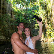 Couple taking selfie at Cenote Ik-Kil