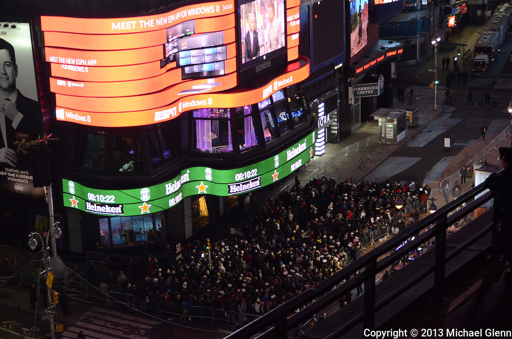 Crowds gathered in Times Square wait for the ball to drop on new years eve