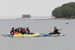 © Rob Arnold.  24/05/2015. Isle of Wight, UK. People out on kayaks enjoying the Bank Holiday Sunday weather at The Duver beach in St. Helens on the Isle of Wight today, Sunday 24th May 2015. Today started warm with sunny spells, and clouded over later in the day in the South of England. Photo credit : Rob Arnold